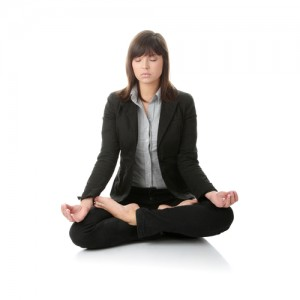 Businesswomen meditating in lotus position.