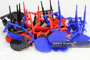Collection of injection molded parts on sprues at Star Rapid