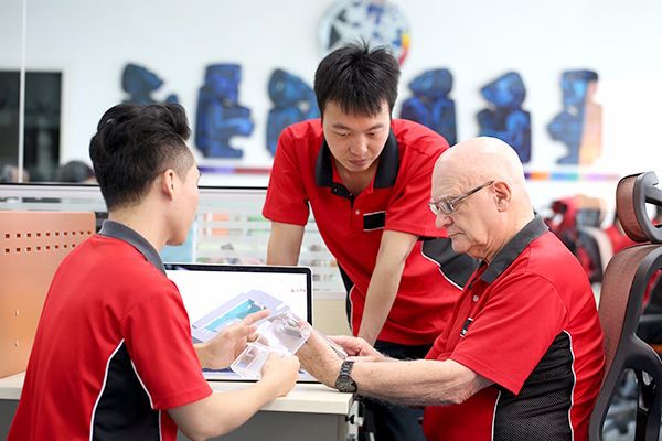 Plastic Injection Molding Engineers at Star Rapid discussing a project