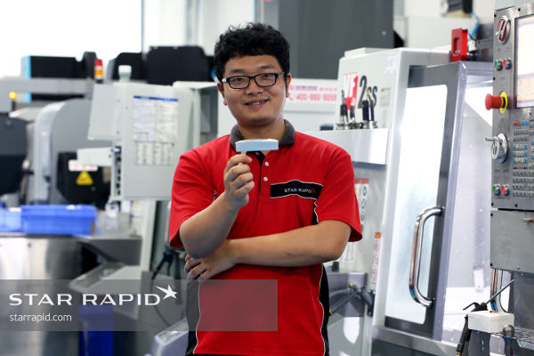 CNC machinist with putter