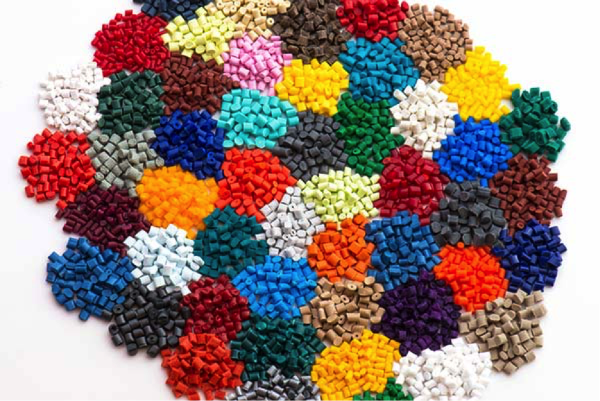 Plastic pellets arranged in a colorful display