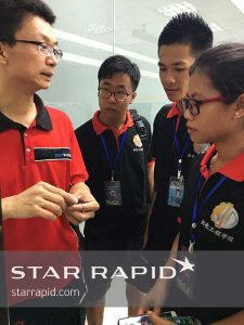 Young engineering graduates taking a factory tour at Star Rapid