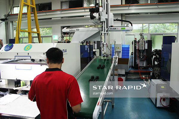 Plastic Injection Molding Machine with robotic conveyor system at Star Rapid