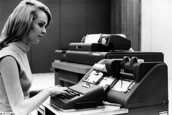 Manual punch card reading from IBM in the 1960s