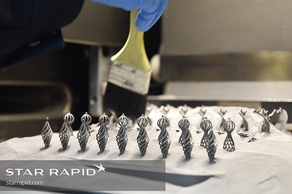 Brushing Ti powder away from 3D printed jewelry