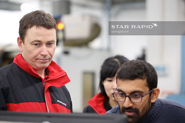 A team of technicians at Star Rapid discuss 3D printing.