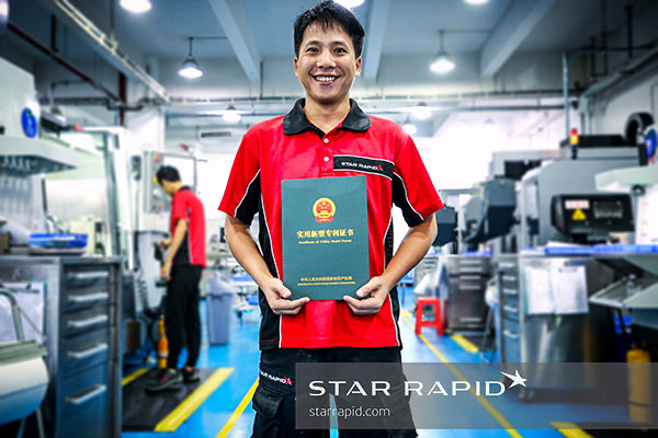 Star Rapid machinist holding patent certification