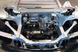 Vacuum impregnated aluminum car frame